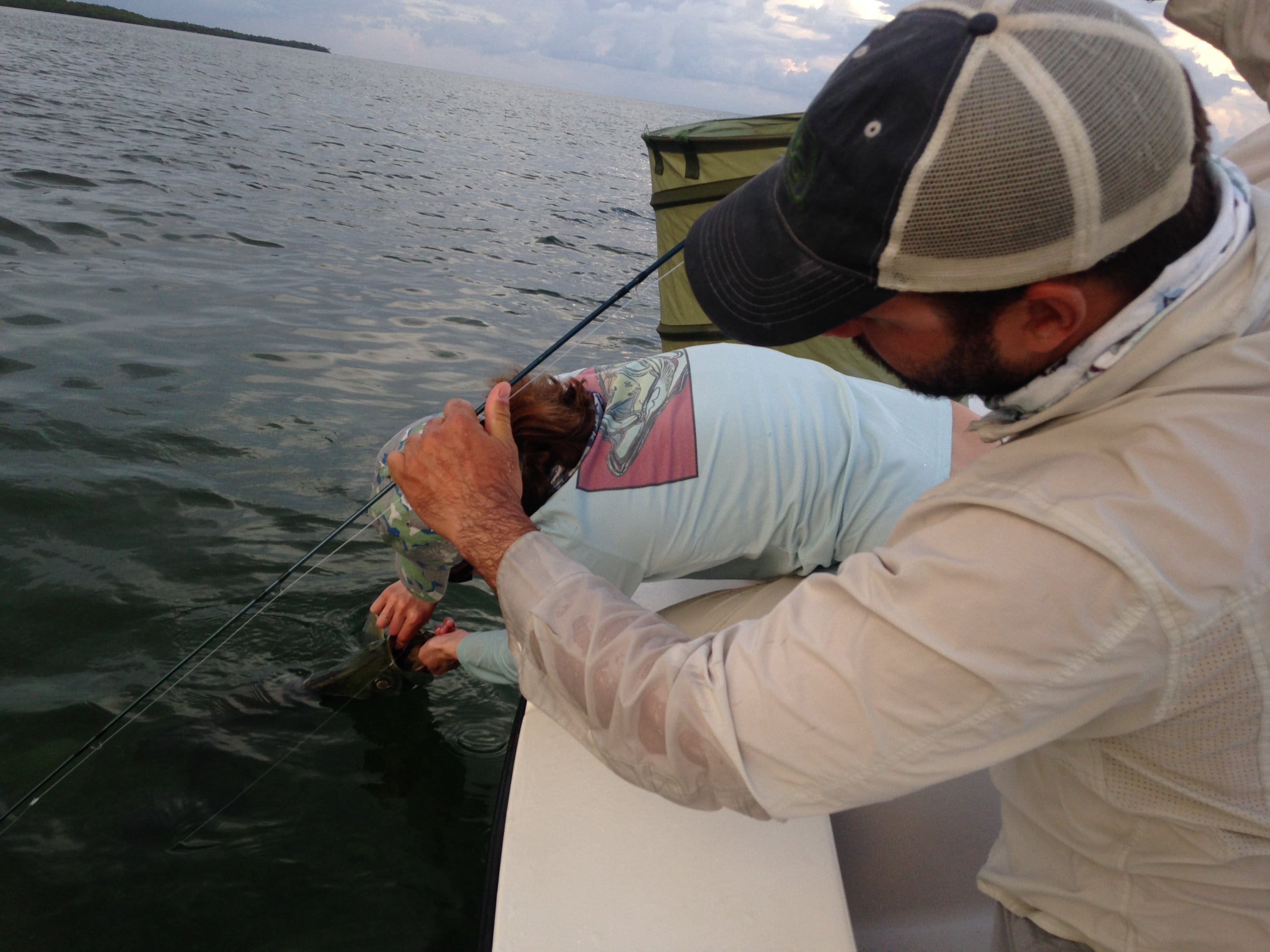 Kat unhooks Nate's tarpon, the second of the day. Photo/guiding Captain Simon Becker