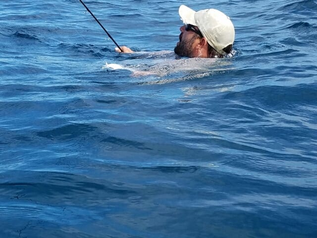 It's hard to explain in a caption why, but Nate ended up in deep water attached to a permit in Belize. Photo/guiding Eworth Garbutt