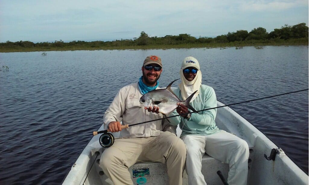 Nathaniel and his first fish from Belize 2015. Guiding Scully Garbutt, photo Michael Hetzel