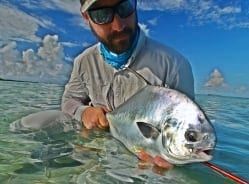 Nathaniel and a small permit caught wading with Simon Becker. Guiding Captain Simon Becker, photo Dave Skok
