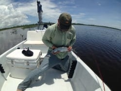Michael Hetzel holds one of many bonefish in Belize. Photo Kathryn Vallilee, guiding Eworth Garbutt