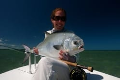Kathryn and an 18 pound permit caught with Captain Drew Delashmit. Photo/guiding Drew Delashmit