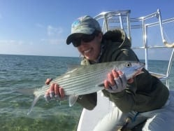 Kathryn and a nice bonefish, caught from the cold with Captain Aaron Snell. Dotty Ballantyne photo, guiding Captain Aaron Snell