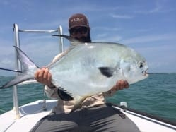 Simon Becker does the guiding and photography for a great capture, 25 pounds of permit.