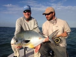 Chad holds a fish for Nate. A great way to start the day. Photo/guiding John O