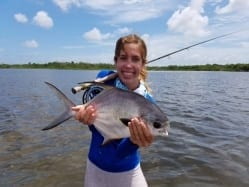 Kathryn holds a potential world record: a permit on 4 pound tippet. Guiding Eworth Garbutt, Photo Nathaniel Linville