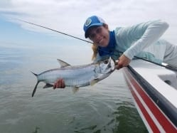 Kathryn and a small tarpon, Belize 2016. Photo/guiding Eworth Garbutt