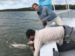 Nate and Kate with a small tarpon to start the day off right despite some tough weather. Guiding/photo courtesy Simon Becker