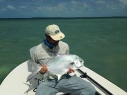 Nathaniel holds a permit, caught with Captain Scott Collins. Kathryn Linville photo