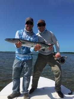 Captain Doug Kilpatrick and Jesse Robbins hold a large fly caught barracuda courtesy of themselves. Photo Nathaniel Linville