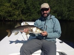 Nathaniel holds the fruit of some labor from Steve Huff, a nice snook. Photo courtesy Steve Huff