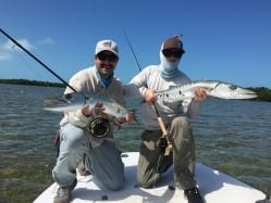 Nathaniel and Jesse pose for the rare 'double cuda' on fly. Guiding and photo Doug Kilpatrick