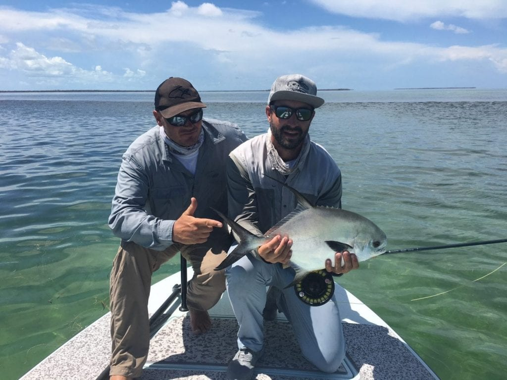 Michael Hetzel and Nathaniel hold a small summer permit. Photo/guiding Ian Slater