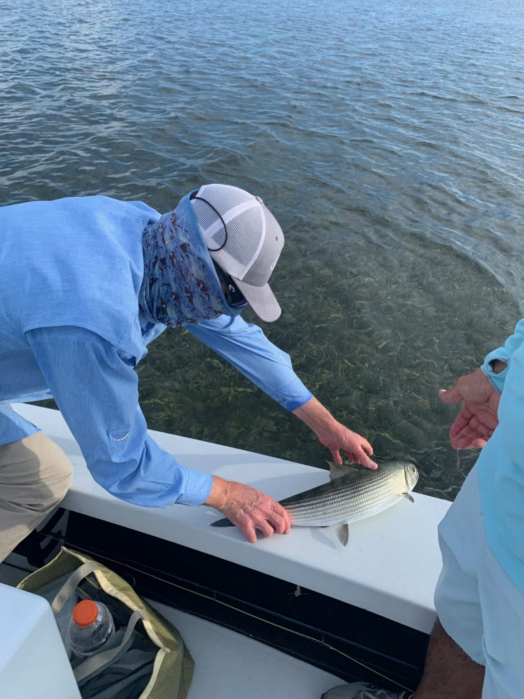 Simon Becker and Dave Dalu release a summer bonefish. Photo  Nathaniel Linville, guiding Simon Becker.