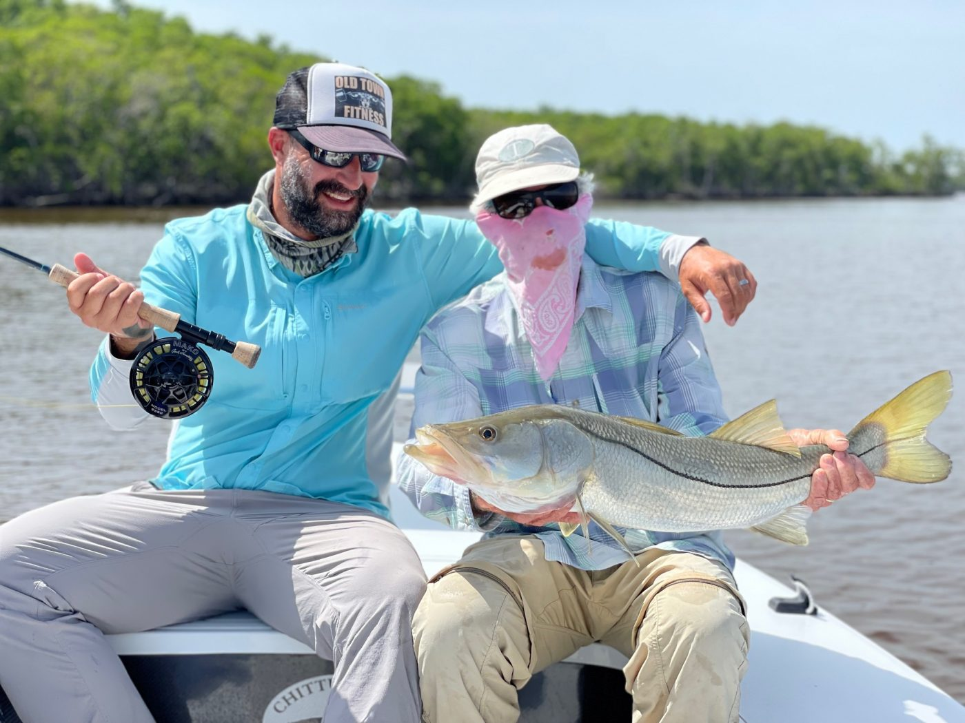 Nate and Steven with a nice snook, caught on 4# tippet. Photo Kat Vallilee, guiding Steve Huff
