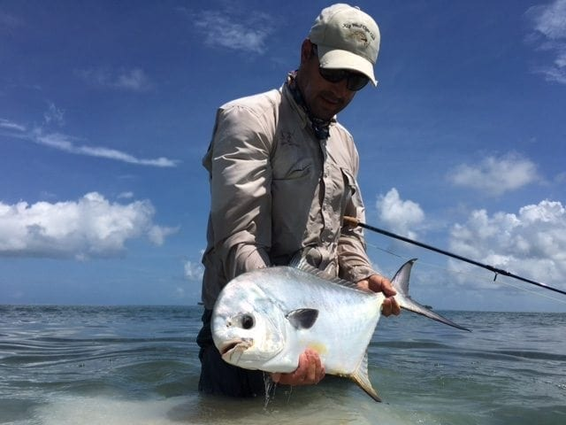 Ian Slater clicks a picture of a nice permit. Guiding/photo Captain Ian Slater